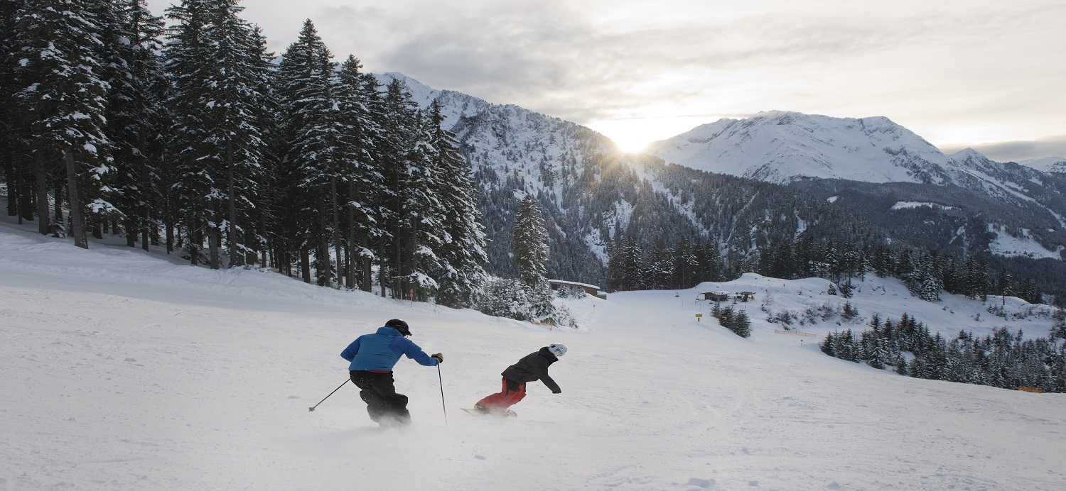 two skiers on the slopes