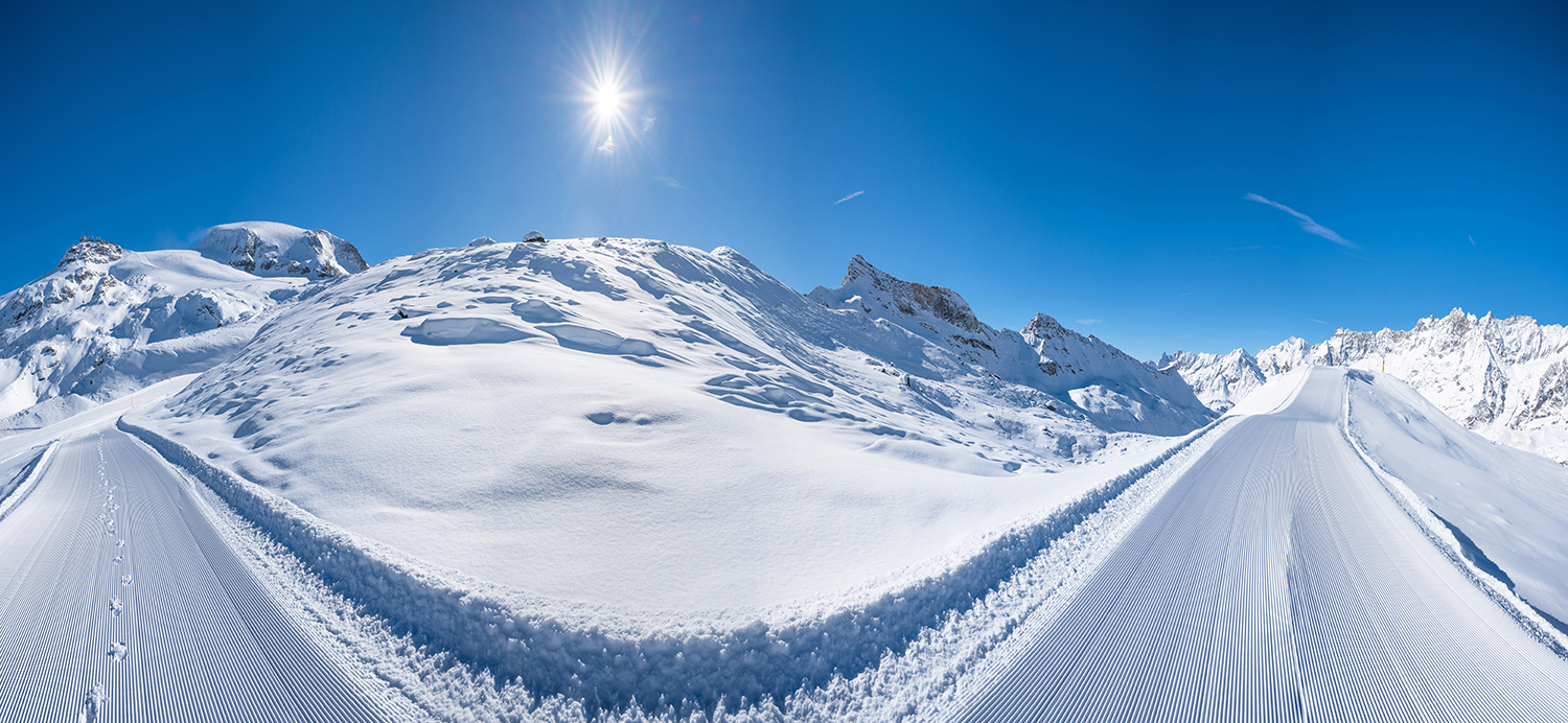 Beautiful panoramic winter landscape with piste