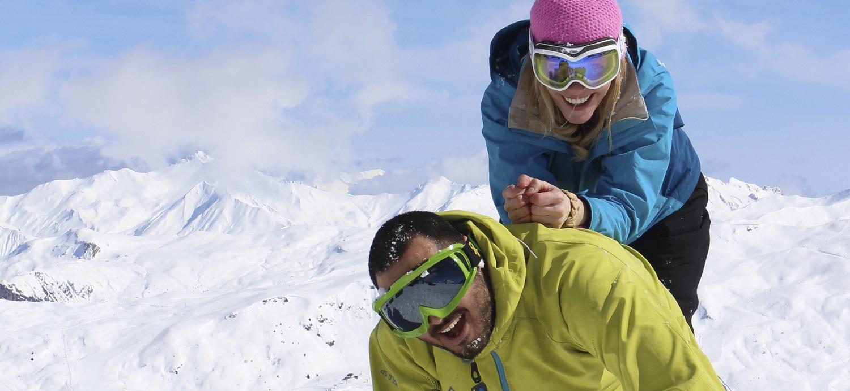 Couples skiing in Meribel