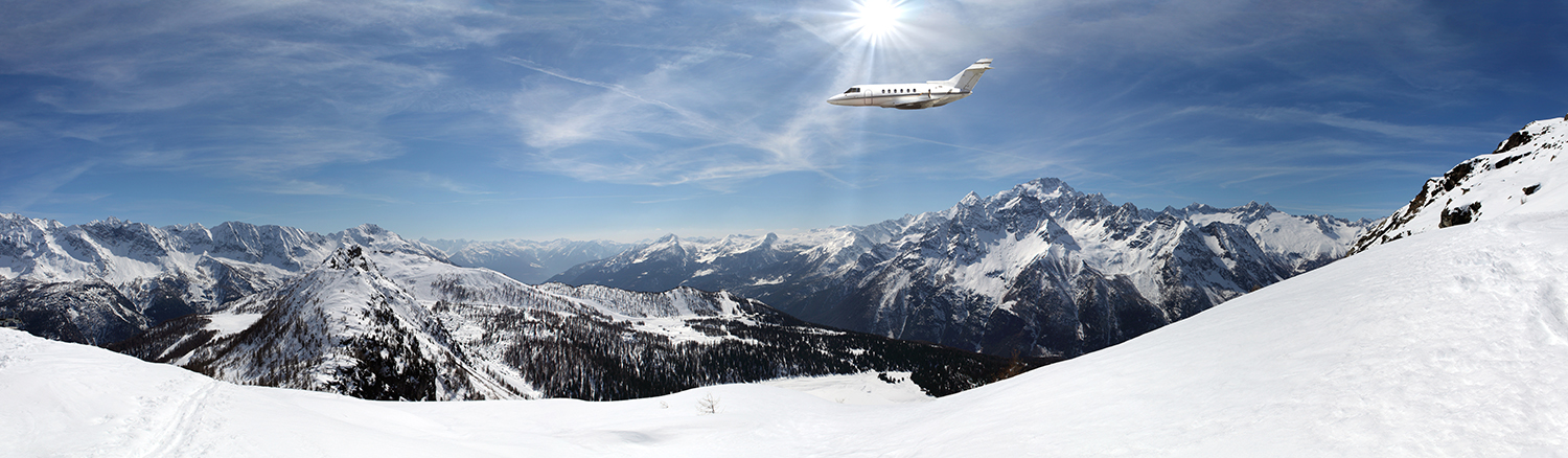 Plane flying over a snow capped mountain