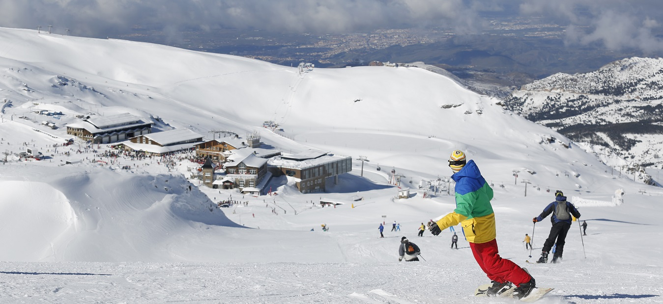 Skier skiing down to the central slopes of Sierra Nevada