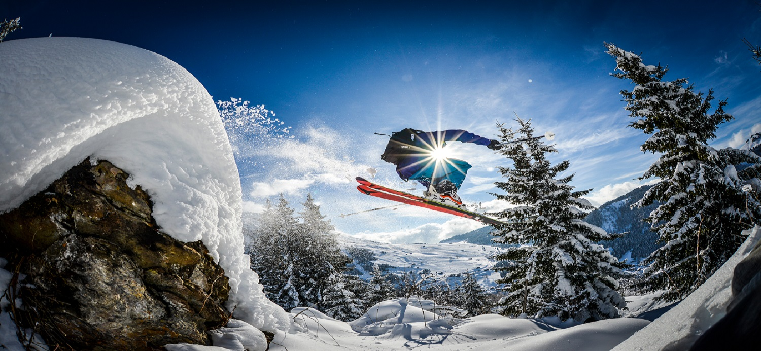 ski jump with sunlight and mountain views