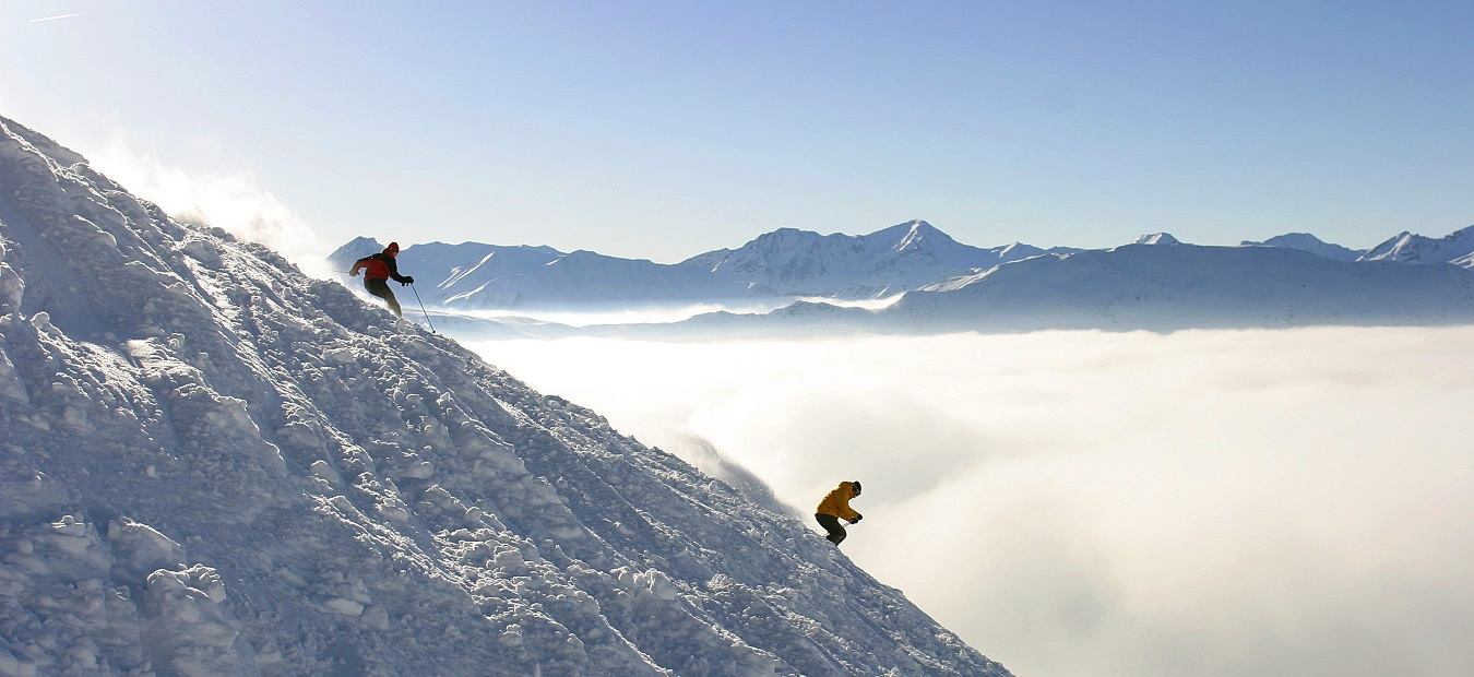 Skiers above the clouds in Brides Les Bains