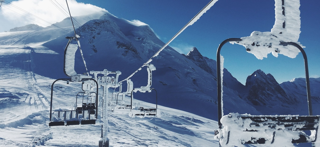 Chairlifts covered in snow