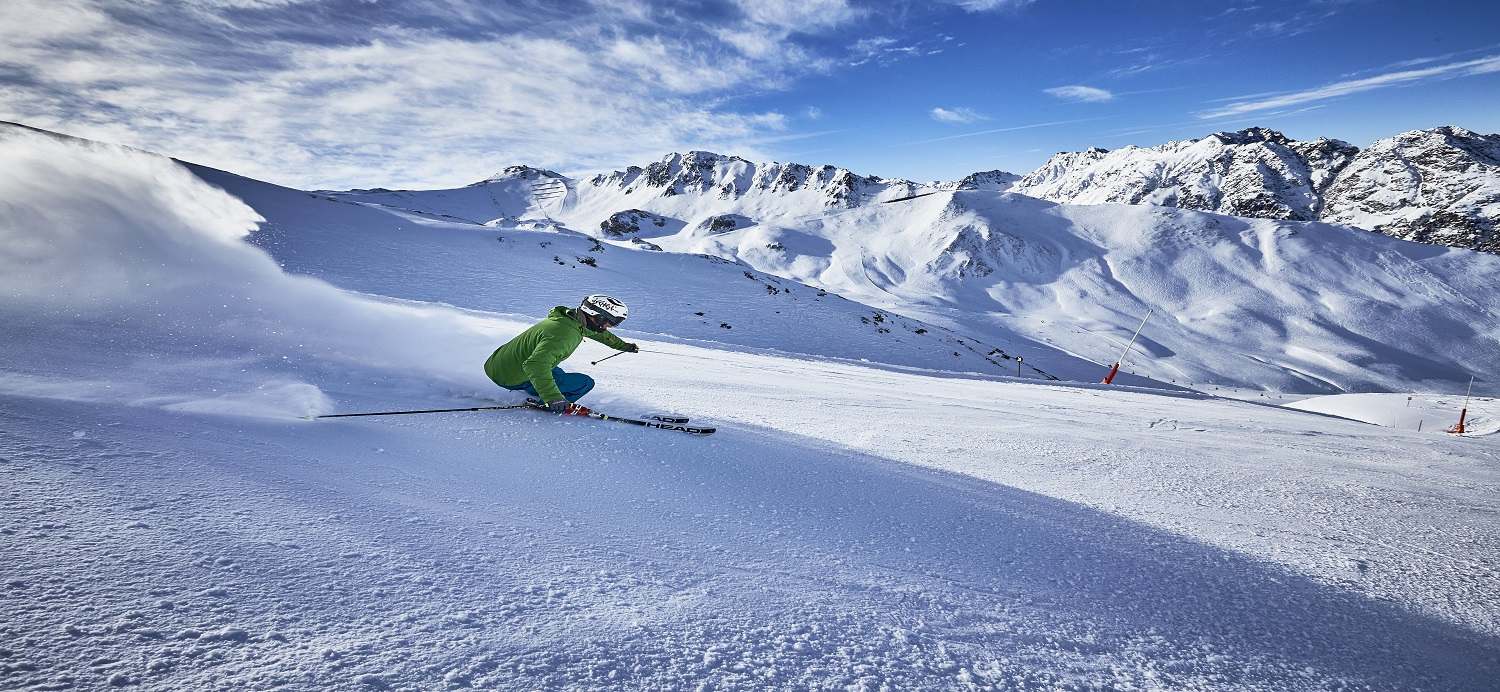 Skier with empty slopes