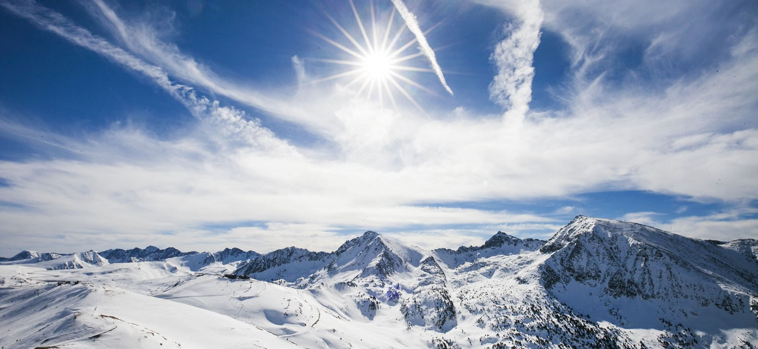 Bright sun and blue sky over the Andorran mountains