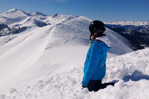 Snowboarder watching the view in Andorra
