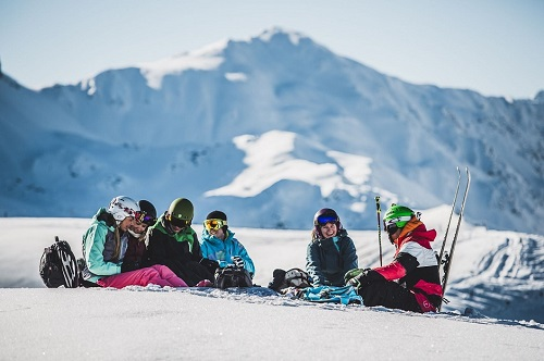 Group of skiers resting in the Austrian alps