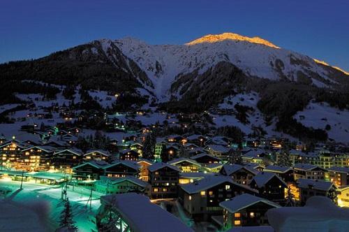 Ski resort lit up at night in Switzerland