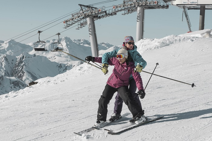 Couple skiing on the slopes
