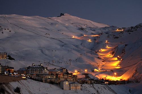 Ski resort in the Spanish Pyrenees with lights up the mountains