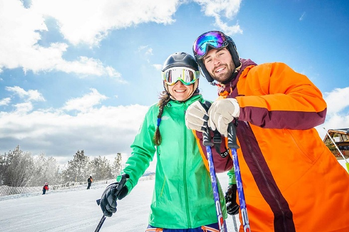 Couple smiling on the slopes