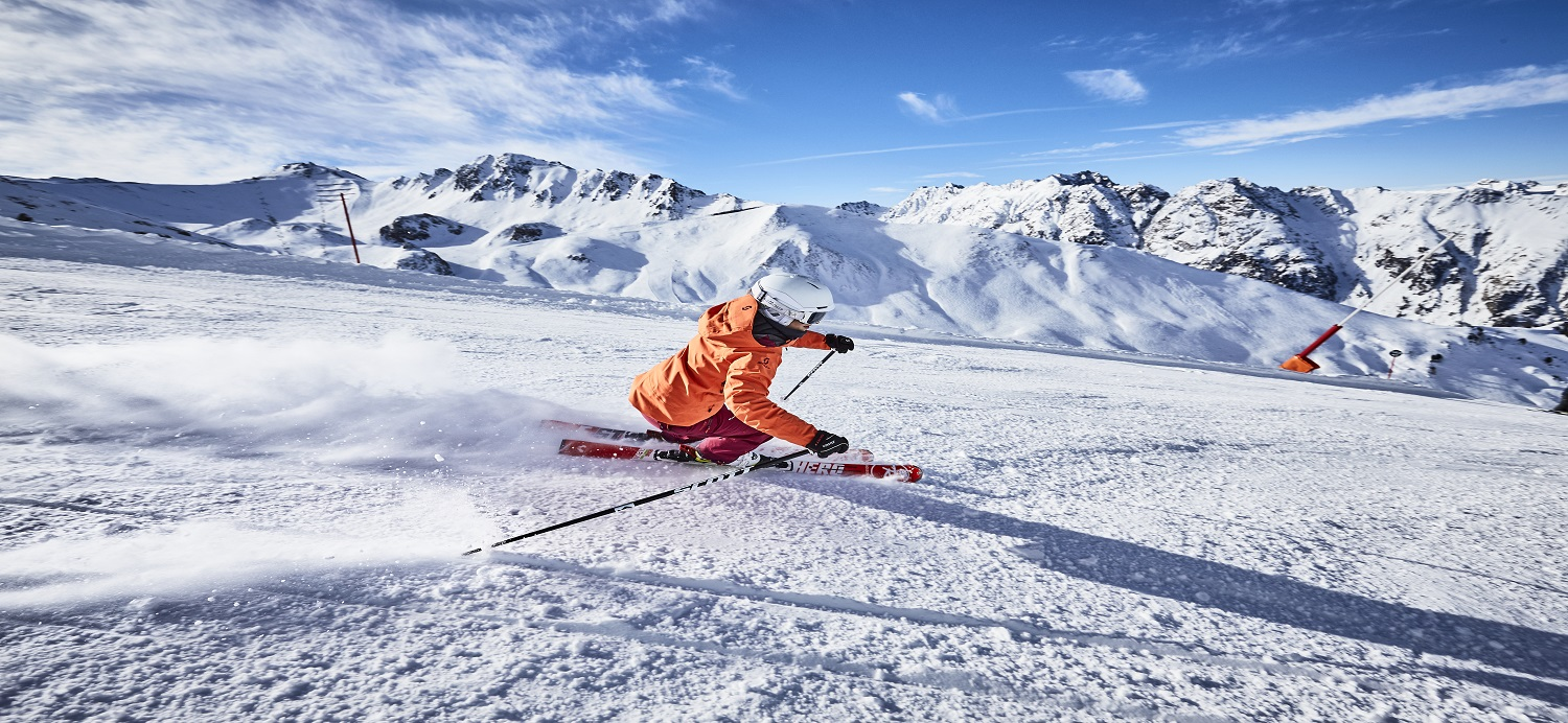 skier with mountain backgrounds