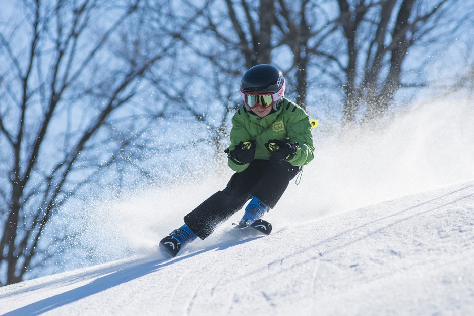Child skiing down a slope