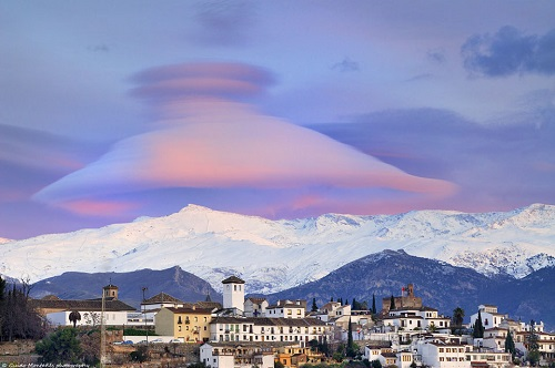 Pink clouds over a Spanish ski mountain village
