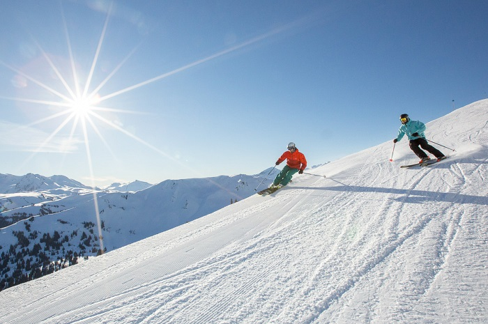 Two skiers coming down the slopes